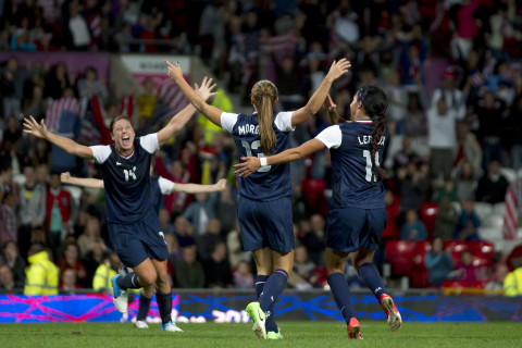 United States' Alex Morgan, center, celebrates with teammates including Abby Wambach, left, and Sydney Leroux after the winning goal was scored past Canada's goalkeeper Erin Mcleod during their semifinal women's soccer match at the 2012 London Summer Olympics, Monday, Aug. 6, 2012, at Old Trafford Stadium in Manchester, England. (AP Photo/Jon Super)