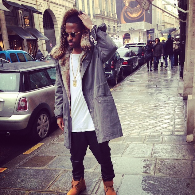 Big-Sean-wearing-Yves-Salomon-Raccoon-Fur-lined-Hooded-Long-Parka-Coat-and-Fear-of-God-LA-basic-tee-in-Paris