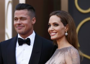 Actor Brad Pitt and his partner, actress Angelina Jolie arrive at the 86th Academy Awards in Hollywood, California March 2, 2014. REUTERS/Lucas Jackson (UNITED STATES - Tags: ENTERTAINMENT)(OSCARS-ARRIVALS)