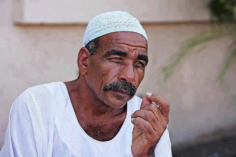 Image result for egyptian man wearing galabeya