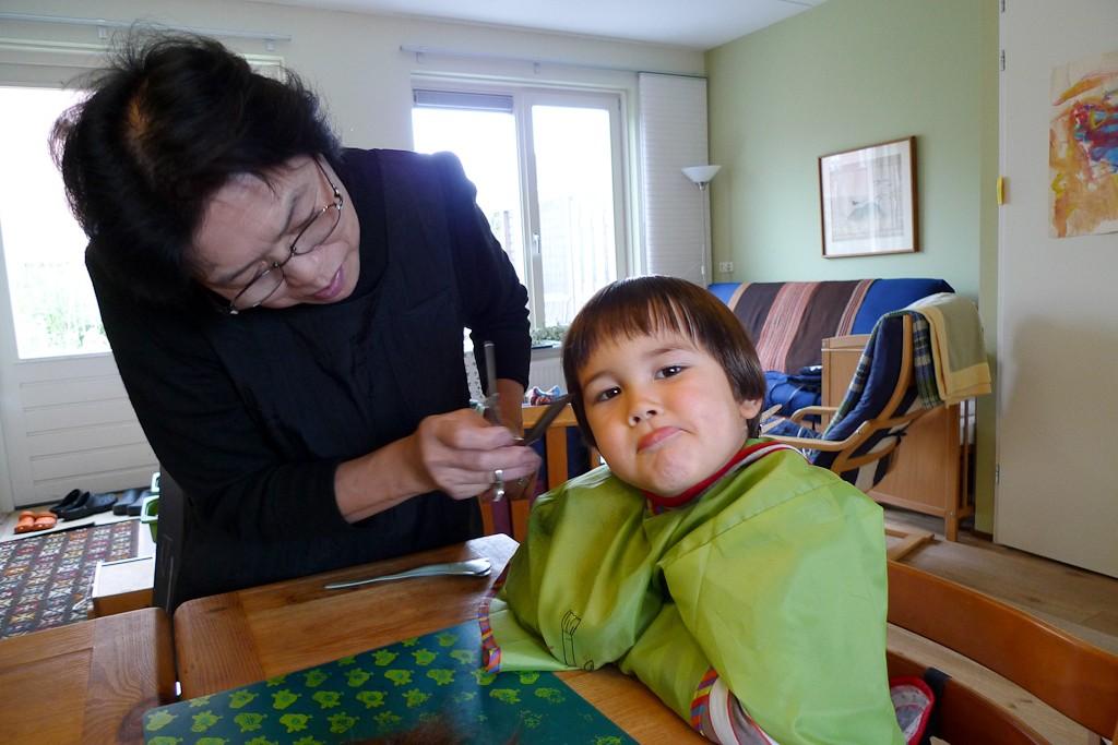 Chizus mom cutting Tys hair