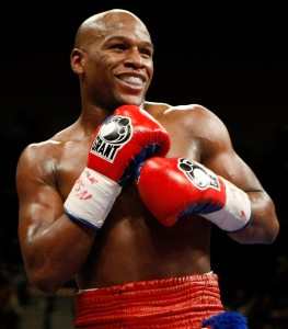 TO GO WITH AFP STORY Floyd Mayweather Jr. smiles in the ring during his fight against Juan Manuel Marquez at the MGM Grand Garden Arena September 19, 2009 in Las Vegas, Nevada. Mayweather won by unanimous decision.   Ethan Miller/Getty Images/AFP (Photo credit should read Ethan Miller/AFP/Getty Images)