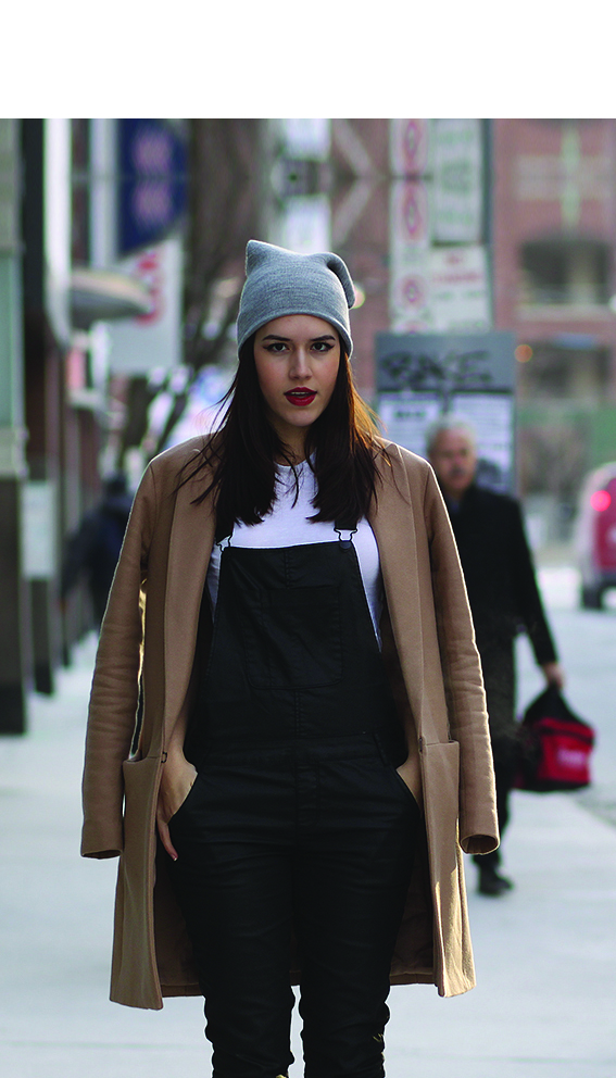 Girl in the street wearing a dungaree