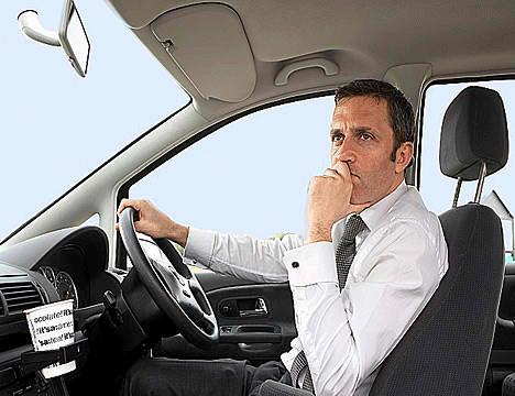 Man_driving-car_110410