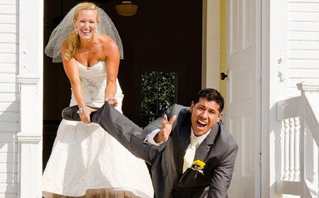 a bride holding her husband on the stairs