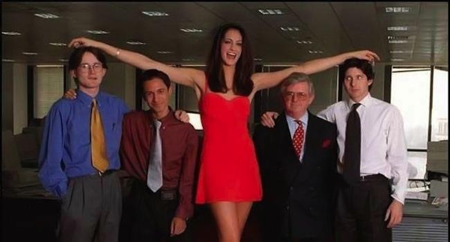 tall girl standing between short guys
