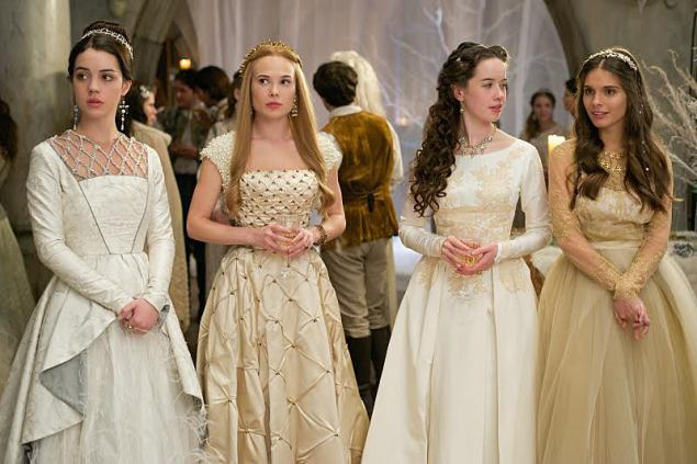 "Reign -- ""Banished"" -- Image Number: RE212a_0095.jpg -- Pictured (L-R): Adelaide Kane as Mary, Queen of Scotland and France, Celina Sinden as Greer, Anna Popplewell as Lola and Caitlin Stasey as Kenna -- Photo: Sven Frenzel/The CW -- © 2014 The CW Network, LLC. All rights reserved."