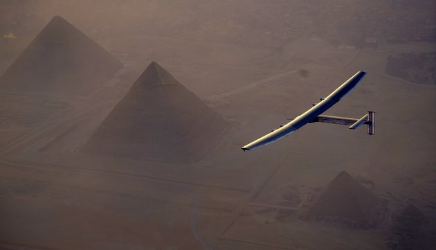 GIZA, EGYPT - JULY 13: Solar Impulse 2, the solar powered plane, flies above Giza Pyramids as Sun-powered aircraft finishes its penultimate flight, landing in Egypt on July 13, 2016 in Giza, Egypt. (Photo by Jean Revillard / Solar Impulse 2 / Pool/Anadolu Agency/Getty Images)